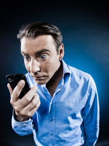 man staring at cellphone