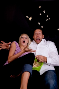 Scared couple in cinema